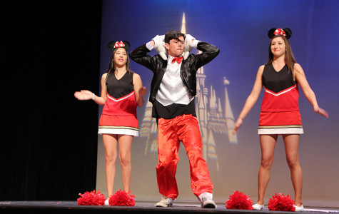 Junior Eli Cullinan preforms Hey Mickey with fellow classmates in the ASL show. The ASL show happens twice every year and is preformed by ASL three and four.