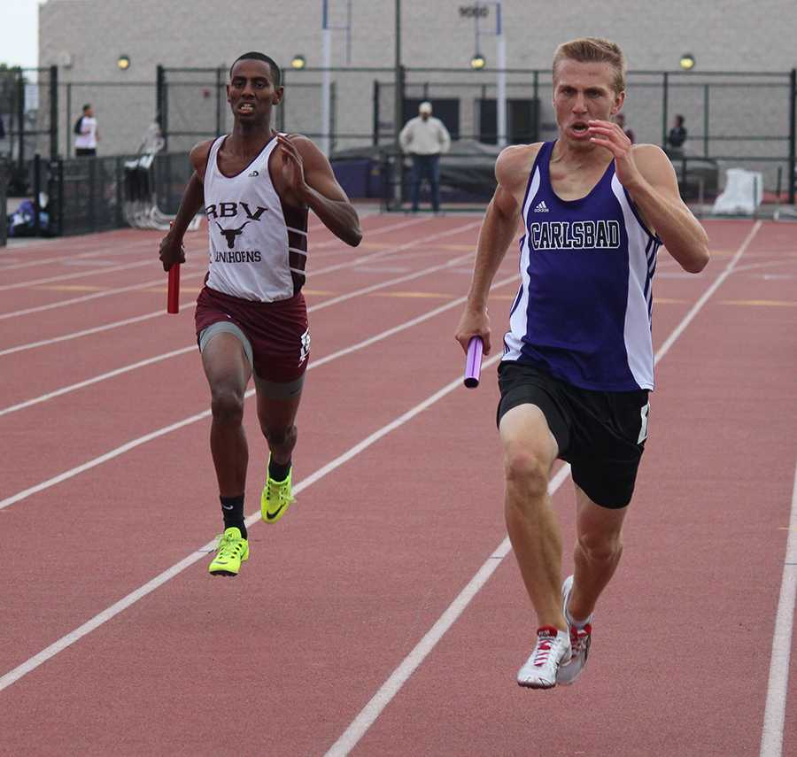 Senior+Tyler+Dresser+runs+in+the+4x400m+race.+Tyler+was+the+anchor%2C+bringing+in+first+place+for+the+boys.+