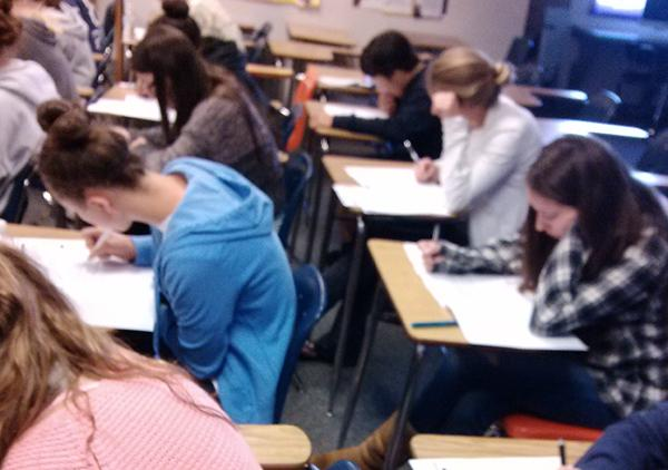 Students focus in on their English 3AP mock test. The test includes a 60 minute multiple choice section and a two hour and fifteen minute essay period.