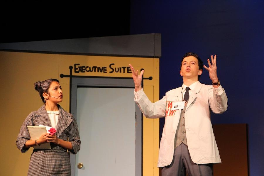 Juniors Karinya Ghiara and Max DeLoach perform during the spring musical How to Succeed in Business Without Really Trying.  The show was filled with great  musical numbers and 60s inspired costumes and characters.