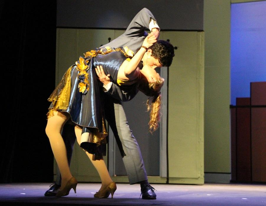 Junior Max DeLoach and Senior Valerie Maybaum embrace in a kiss on stage.