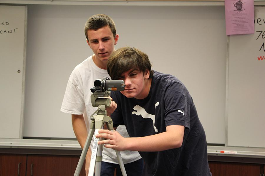 Seniors Sam Krimmer and Stewart Freedman set up for a shoot. Film academy, a three-year program now, gives students the opportunity to master their film-making skills.