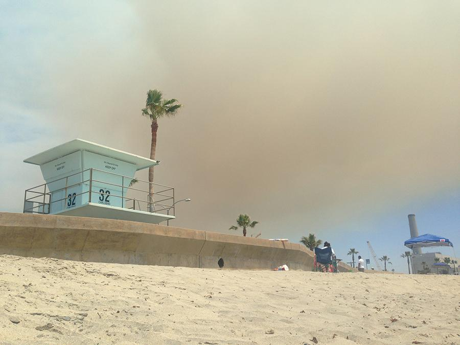 A+smoke+cloud+stretches+over+Tower+32+on+Carlsbad+State+Beach+on+May+14.++The+Poinsettia+Fire%2C+which+began+at+approximately+10%3A30+a.m.%2C+killed+one+person+and+destroyed++or+significantly+damaged+eight+homes%2C+an+18-unit+apartment+complex+and+two+commercial+buildings+as+it+burned+600+acres+throughout+Carlsbad.
