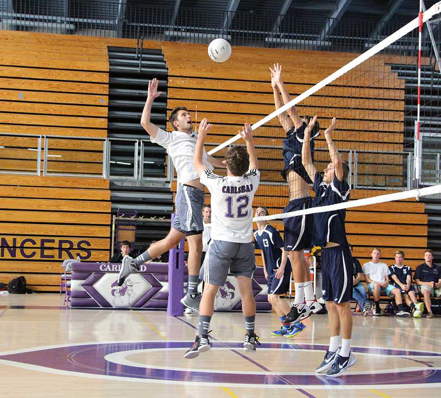 Junior Anthony DeRose goes up for a kill against SDA. On April 30 the boys volleyball team took on SDA and won their match in the third game.