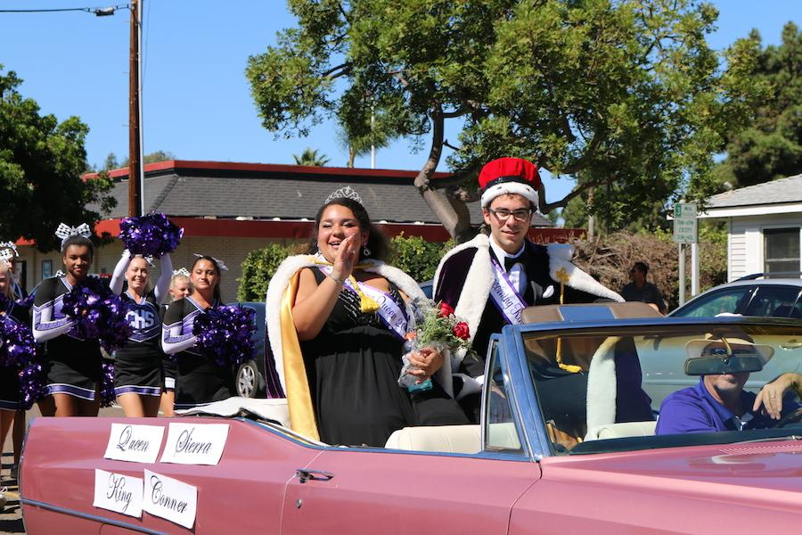 Seniors+Sierra+Gonzalez+and+Conner+Shaw+ride+in+the+Lancer+Day+Parade+as+this+year%27s+Homecoming+King+and+Queen.++Gonzalez+and+Shaw+have+been+part+of+Chambers+choir+and+band%2C+respectively%2C+since+freshman+year.
