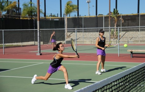 Junior Katlyn DeShon and senior Sandra Shin played doubles during the game against Vista. Lancers came out with a win by 11-7.