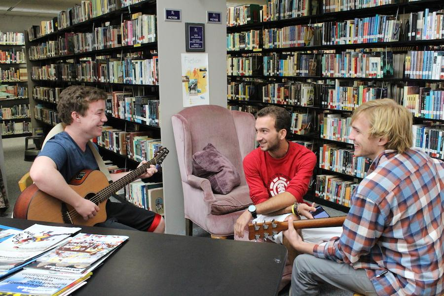 Members of Acoustic Club jam out during lunch in the back of the library.  They meet every Friday, and anyone and everyone is welcome.