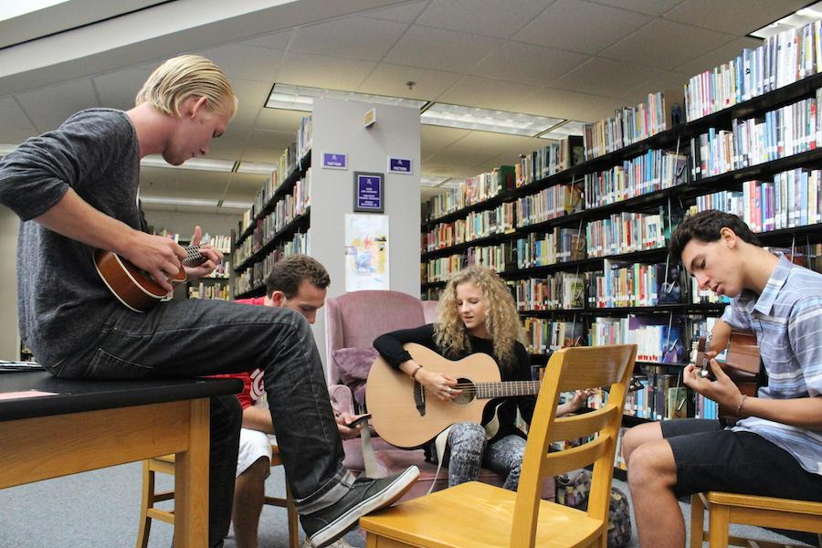 Members of Acoustic Club Connor Watson, Socrates Kanetakis, Peroline Rouillard, and Brett Nedelman enjoy playing all different kinds of stringed interments.  Acoustic Club meets every Friday in the library.