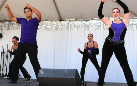 Juniors and members of XCalibur, David Rodriguez and Megan Schoen perform their routine with the rest of the team at Art Splash on Sept. 27.  Rodriguez enjoys bonding with his team as well as working hard to create fruitful routines.
