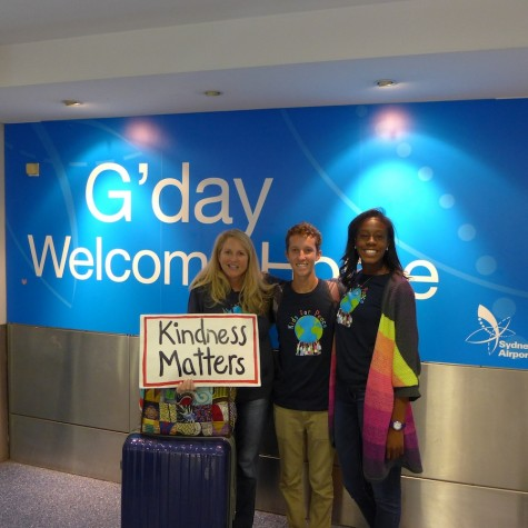 Fresh off the plane, Grady, Jill and Adoley take a moment to represent the World Kindness Movement at the airport.