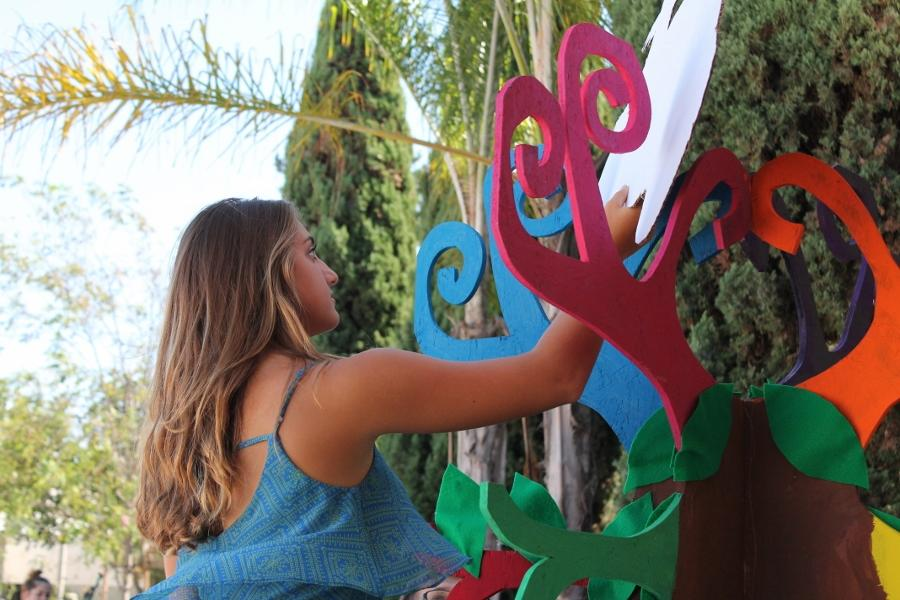 Sophomore Lexi Mertz, works hard on the sophomore float for Fridays parade. The parade will be held in the village of Carlsbad Sept 19,2014