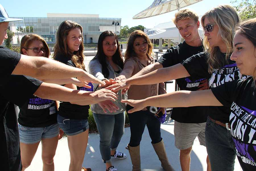 Carlsbad High School leaders take part in a huddle at the CHS leadership conference. The leadership conference took place on the twenty third of August and involved over 100 CHS students.