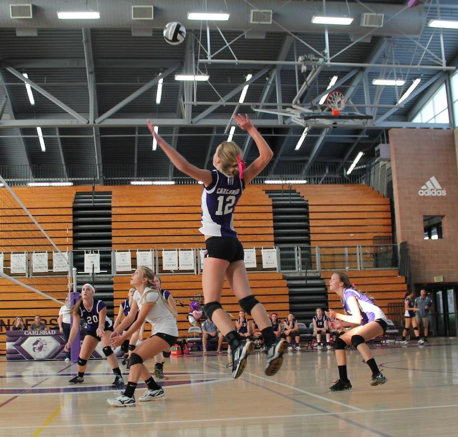 Senior Sara Brower spikes the ball against El Camino to gain the point. The Lady Lancer won in three straight sets.