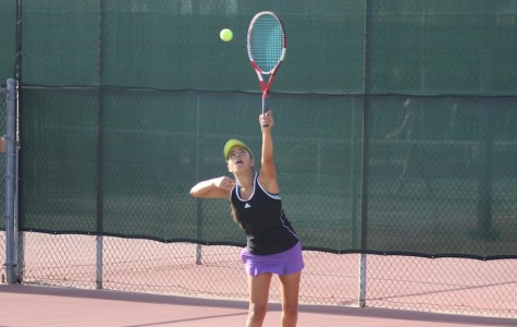 Senior Danny Tajimaroa goes up for a serve against LCC. Although Carlsbad lost the game they still put up a good fight.
