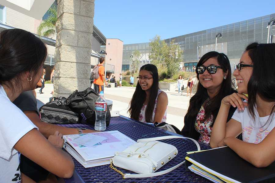 Senior, Kyra Carillo, and her friends catch up at lunch. These girls have stayed in their tight-knit group since they were in the eighth grade.