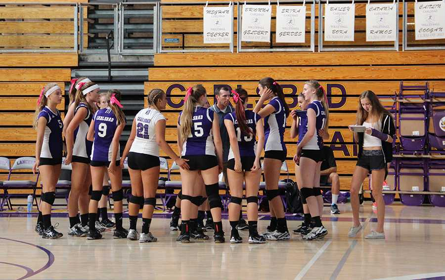 Carlsbad girls varsity volleyball huddles up to hear what their new coach has to say to improve their game. Carlsbad beat the Vista Panthers in three straight matches for a sweep.