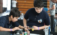 Two members of the Valley Robotics Club set up their  robot in preperation for their event. On Sat. 15, 2014 Carlsbad High Schools own Robotics club hosted a robotics competition for local schools.