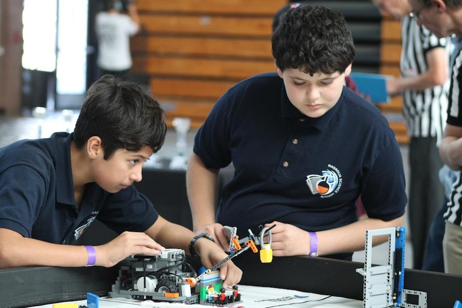 Two+members+of+the+Valley+Robotics+Club+set+up+their++robot+in+preperation+for+their+event.+On+Sat.+15%2C+2014+Carlsbad+High+Schools+own+Robotics+club+hosted+a+robotics+competition+for+local+schools.