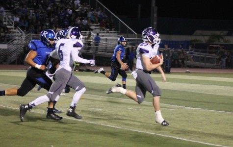 Senior Dylan Rutledge breaks through the Bulldogs defense in an attempt to score a touchdown. Unfortunately, our Carlsbad Lancers could not beat the Ramona Bulldogs.