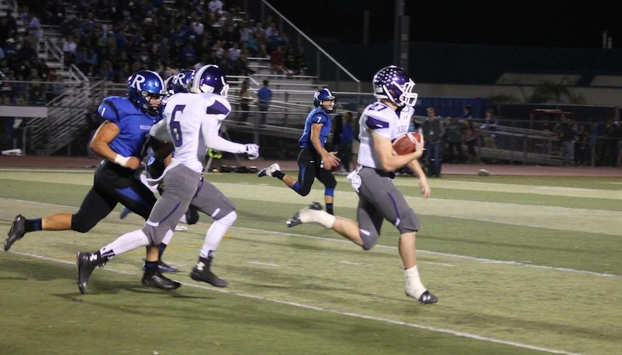 Senior+Dylan+Rutledge+breaks+through+the+Bulldogs+defense+in+an+attempt+to+score+a+touchdown.+Unfortunately%2C+our+Carlsbad+Lancers+could+not+beat+the+Ramona+Bulldogs.