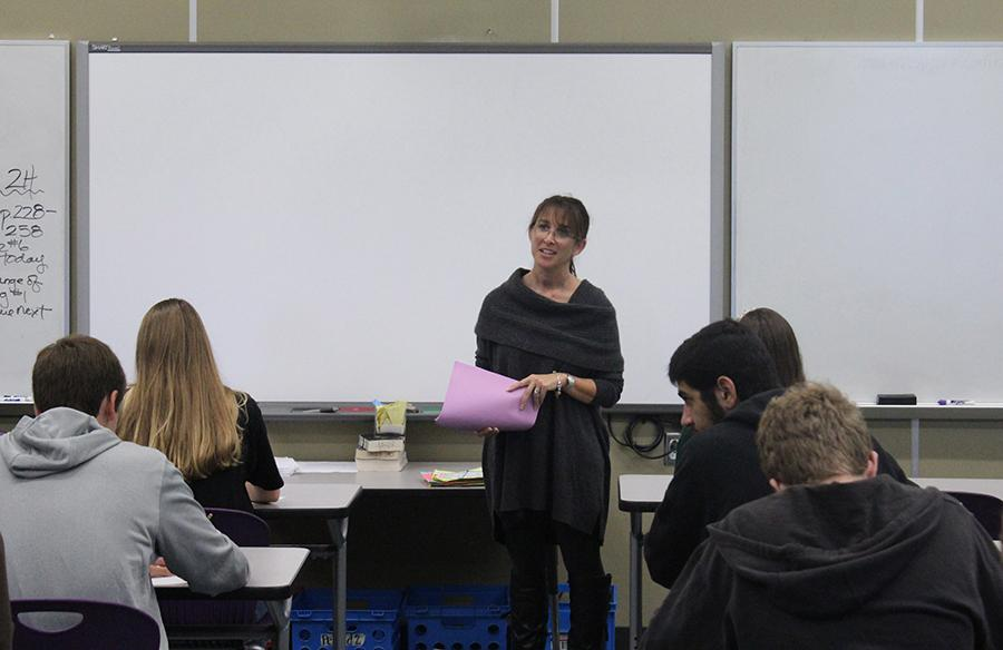 Mrs. Nasser talks to her students about an upcoming quiz on the novel they are reading.
