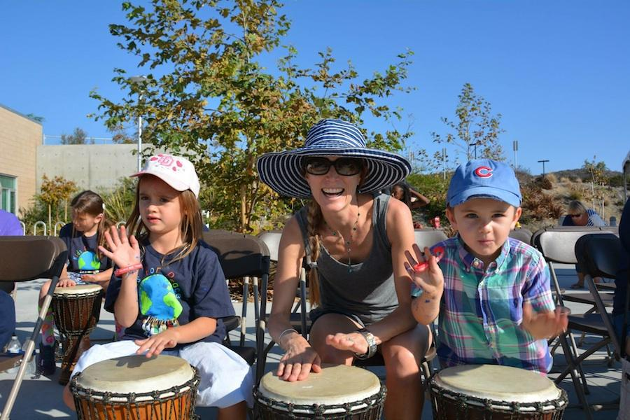 Laughter+and+smiles+were+seen+all+around+as+attendees+participated+in+a+free+drum+lesson.+