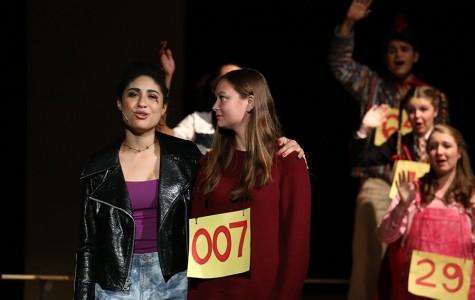 Senior Hannah Allen sings goodbye to the last audience volunteer speller.