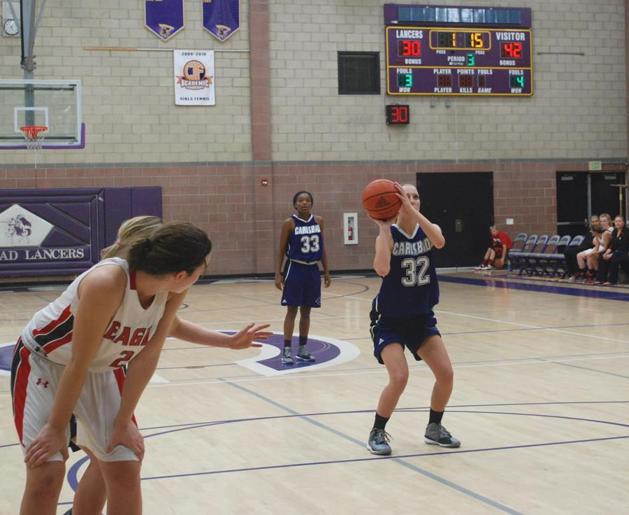 +Carlsbad+varsity+basketball+player%2C+Dominique+Liebentritt+goes+for+a+free+throw+shot+on+Wednesdays+game+against+Santa+Fe+Christian.+The+games+throughout+the+week+were+part+of+the+third+annual+Jason+Harper+tournament.