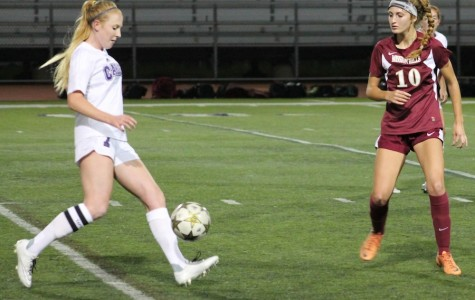 Senior Hannah Miller dribbles the ball down the field at the Carlsbad vs. Mission Hills game on Dec.4. The Lady Lancers won  4 to 1.