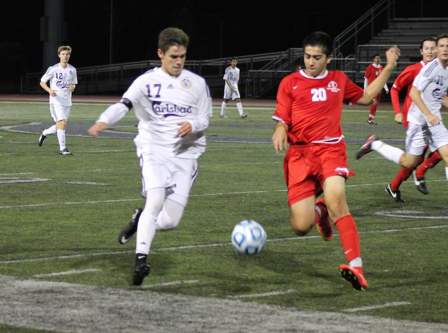 Senior Emilio Bunnell races to get the ball before a Fallbrook player can gain possession. Later on, Emilio scored the only goal in the game grabbing a win for Carlsbad.
