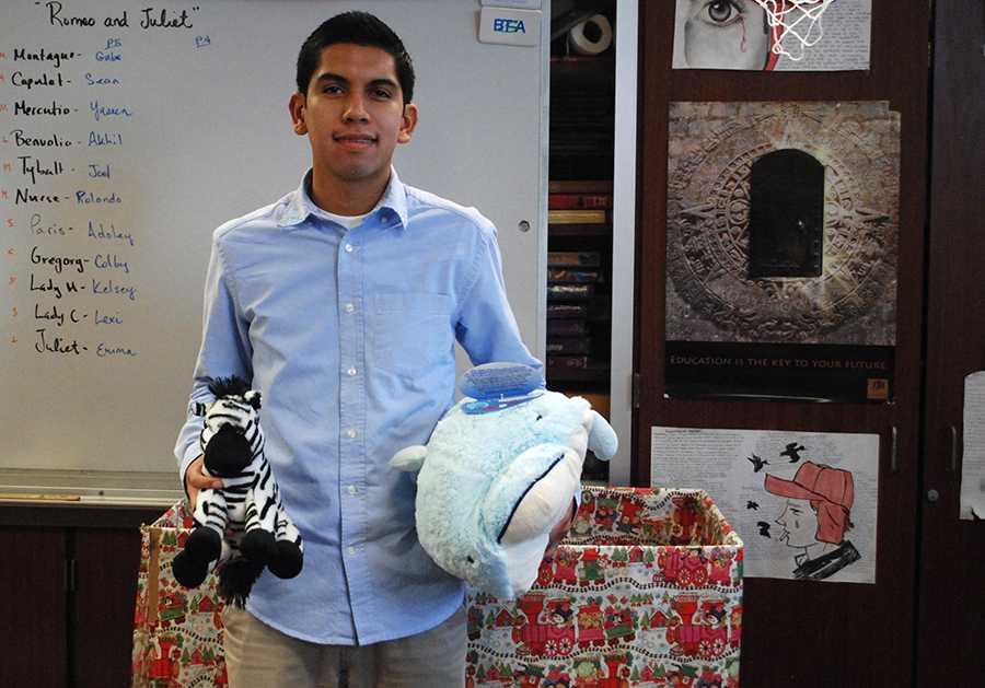 President of Encuentros club, Senior Eric Dominquez, leads an annual toy drive. The toys all go to Casa de Amparo in San Marcos.