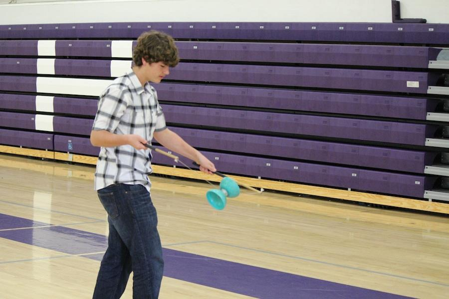 Freshman, Cody Roberts, shows off his tricks for the camera. At juggling club students can test their skill with a variety of gadgets. This club meets every Wednesday in the old gym.