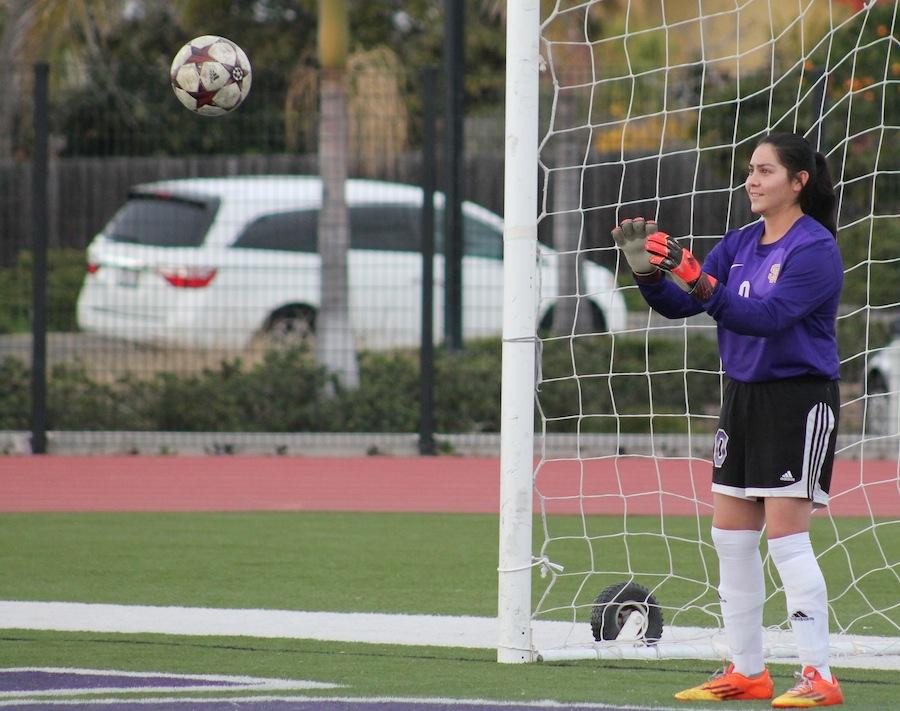 Sophomore Yesenia Betanacourt saves a goal. Besides playing soccer Betanacourt is the point guard for the girls jv basketball team.