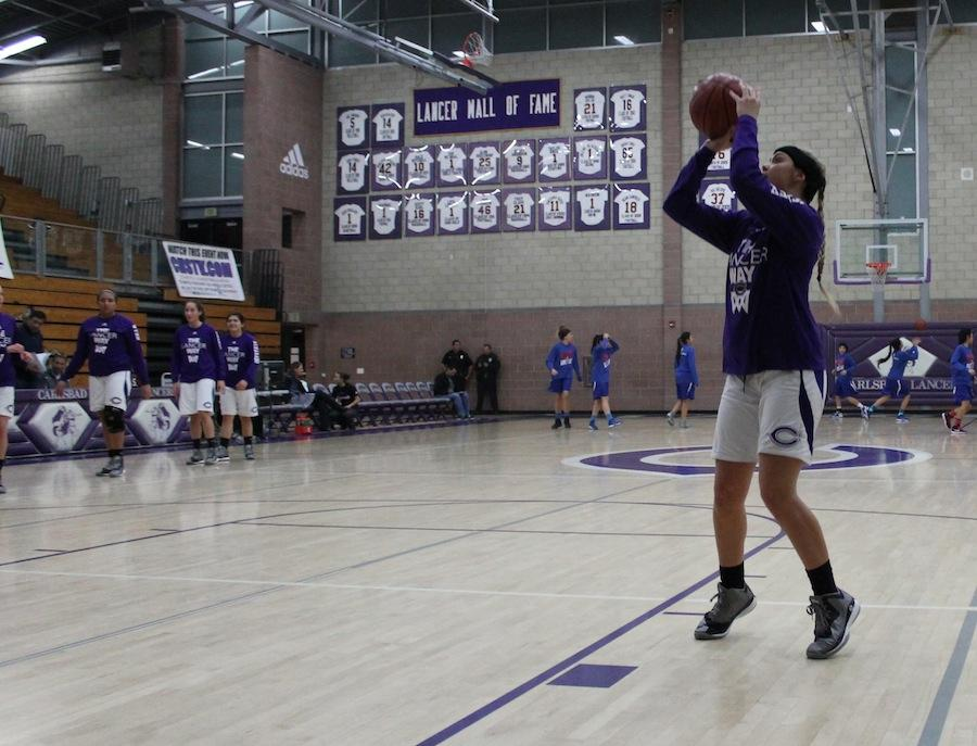 Senior Danielle Bosley warms up before the game against Orange Glen High School Jan. 9, 2015. Bosley has been on varsity for two years.