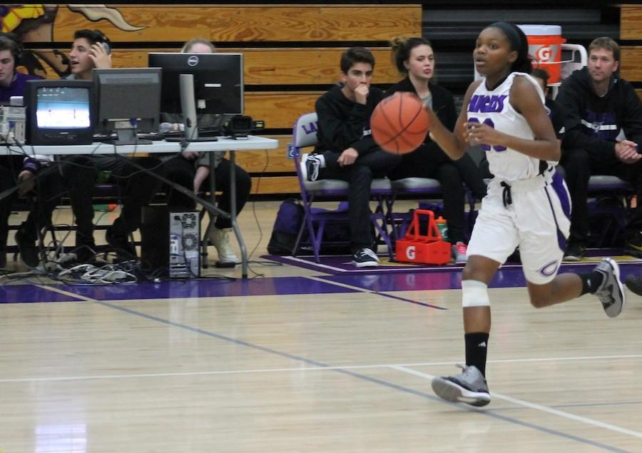 Sophomore Samayra Reed dribbles down the court as point guard in a game against Orange Glen High School on Jan,9. This is Reeds first year on varsity