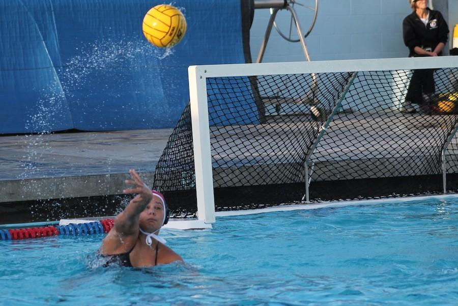 Senior+Savannah+Manley+throws+the+ball+to+a+fellow+team+mate+after+saving+the+ball+on+Jan27%2C2015.+Manley+plays+goalie+for+the+varsity+water+polo+team.