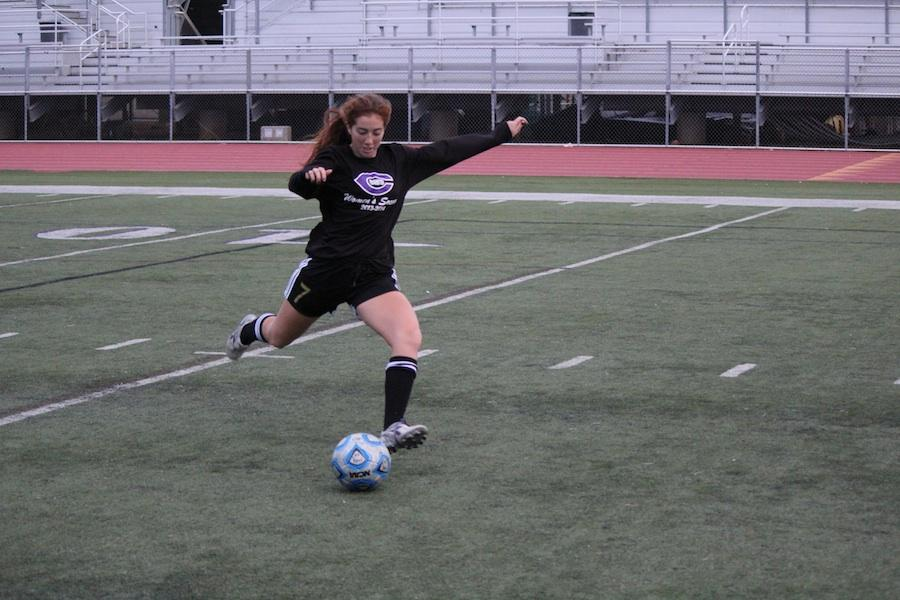 Senior, Rosie Medina, winds up to take a practice shot. Rosie is playing  her second second season on varsity soccer and plays center midfield.