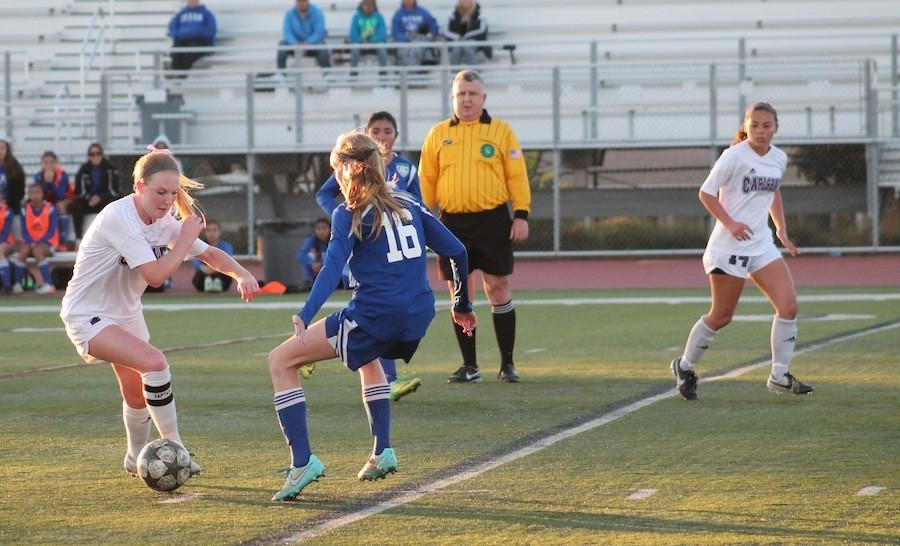 Senior Hannah Miller dribbles down the the field at their CIF game on Feb. 25,2015 against East Lake High School. This is Millers third year on Varsity.