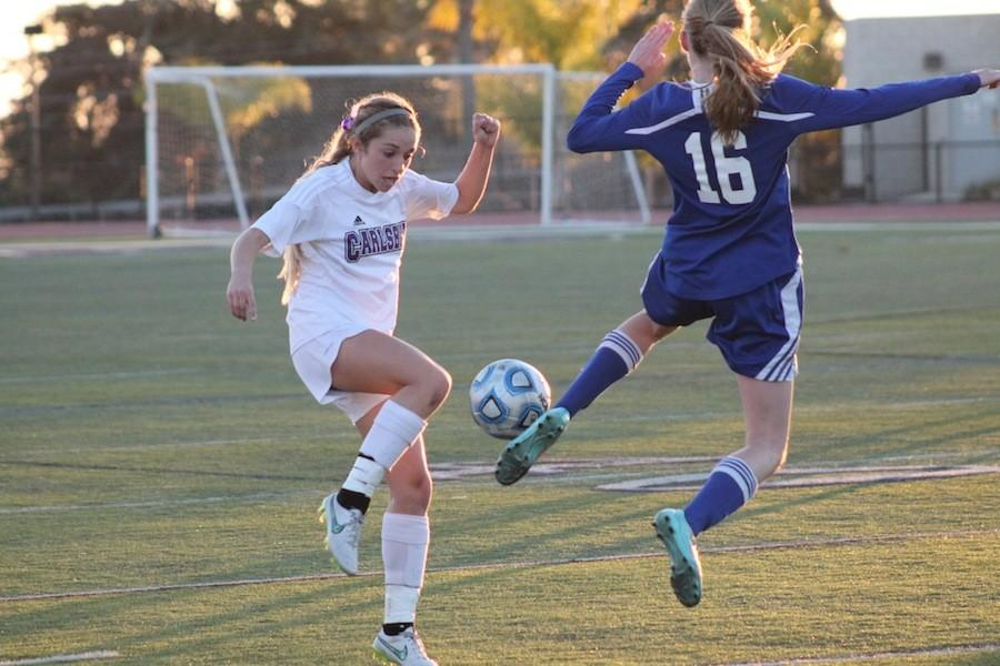 Sophomore Erin Sinai fights for the ball on Feb. 25, 2015. Sinia has been on varsity since her freshman year.