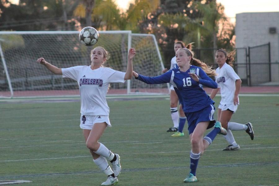 Sophomore Erin Sinai dribbles down the field against East Like High School. Sinai is a defender for the Lady Lancers varsity soccer team.