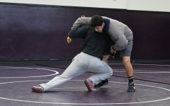Senior, Josh Jeetan, wrestles his teammate to prepare for their CIF playoff matches. As always, Lancers are hoping to obtain a victory this year.