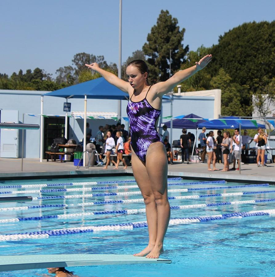 Senior%2C+Delainey+Carlin%2C+prepares+for+a+warmup+dive.+Lancers+triumphed+over+San+Marcos+High+School+at+the+home+meet+on+Friday.+