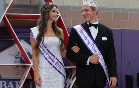 Senior Michael Ricci walks down the court as a prince during the 2014 homecoming. Ricci is not only involved in ASB, but also football and chstv.
