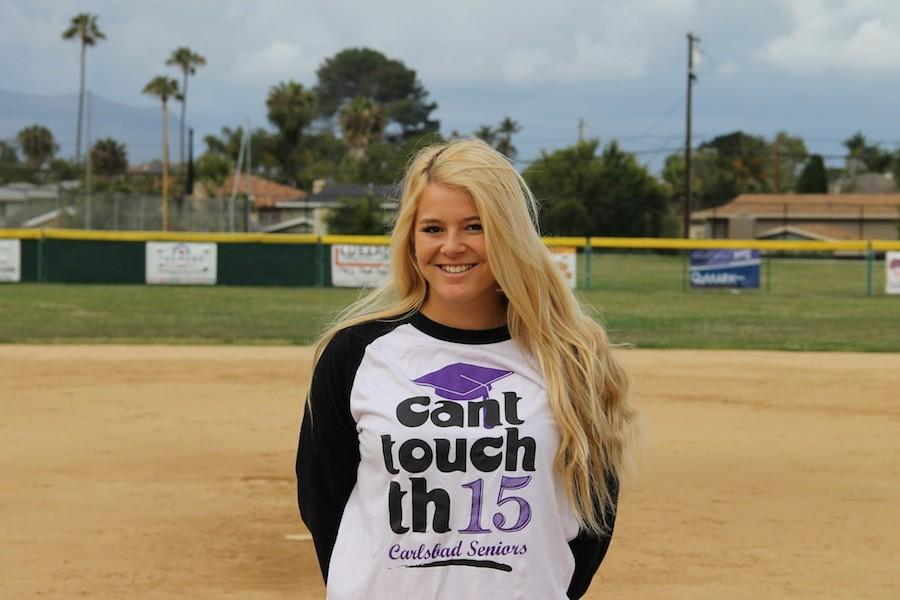 Senior, Delainy Ogan, poses on the softball field. This year, Delainy will play her second season on the varsity team.