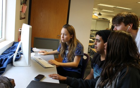 Students in Mr.Brandmeyer's filmmaking  class work in groups often.  They were editing their upcoming film.