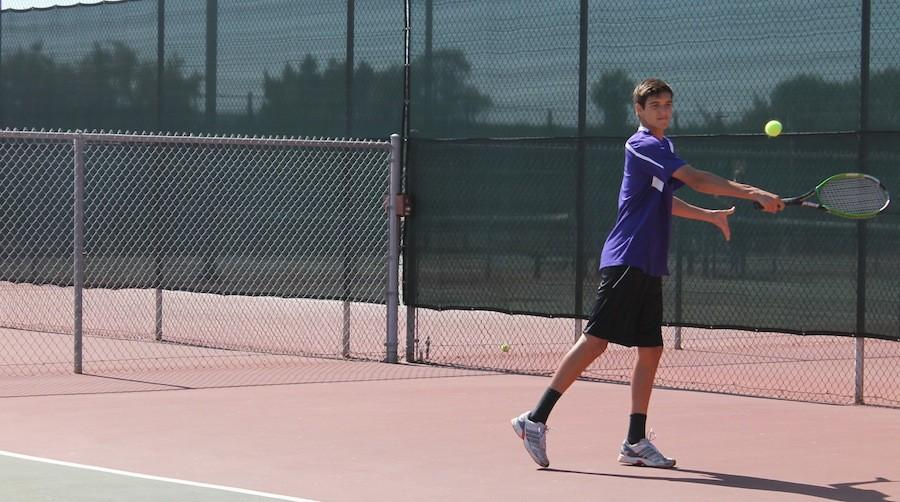 Senior Moritz Liyange goes in to hit a back hand against El Camino on March 24, 2015. The boys team won after several tuff rallies.