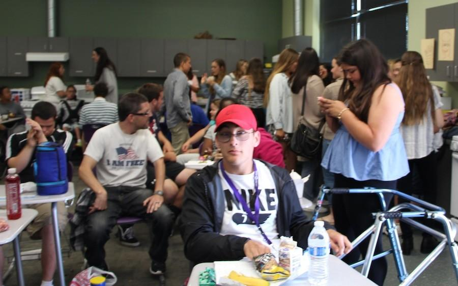 Best Buddies member mingle with one another during the meeting on April 15, 2015. Best Buddies meets every wednesday.
