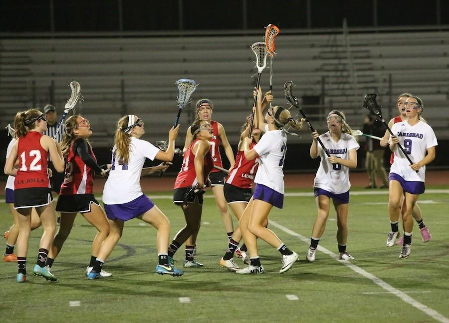 Womens varsity lacrosse plays in a game against La Jolla High School in Thurday, April 30.  Going into overtime in the second half, the team lost by one point.