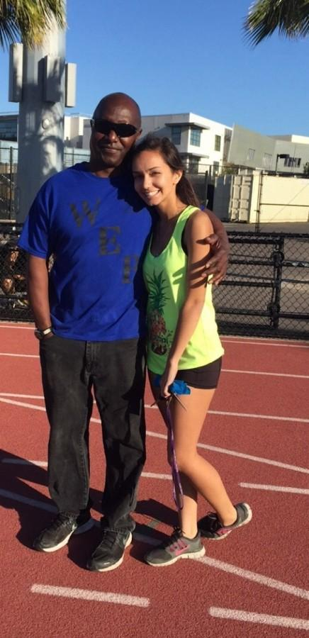 Senior Sarah Lang poses with Coach Charles Daniel. Recently Coach Charles suffered a stroke, the team is banding together on gofundme.com to raise money for Daniels and his family.