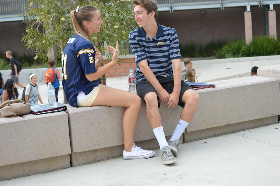 Seniors Delaney Benson and Jacob McMahon show off their sports wear during day 1 of homecoming spirit week.